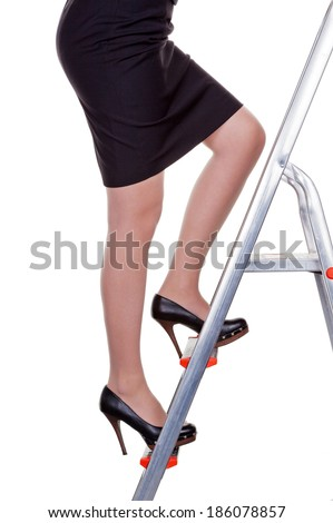 a woman in management climbing the career ladder. more women in leadership positions. - stock photo