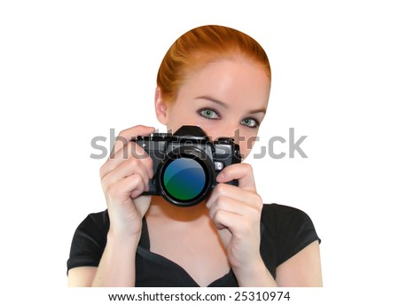 A woman is holding a camera and looking into a camera ready to take a photo. - stock photo