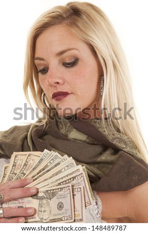 A woman is holding a fan of money - stock photo