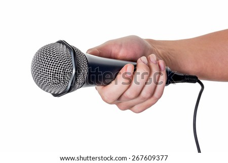 a woman is holding a microphone in his hand. interview and poll - stock photo