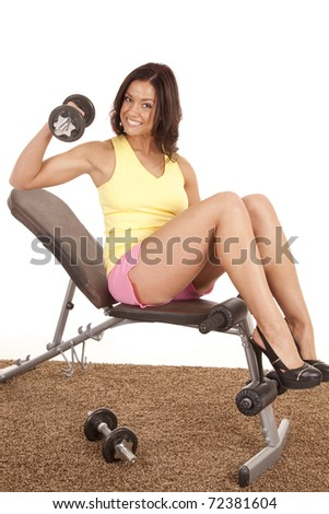 A woman is sitting on a bench in heels working out. - stock photo