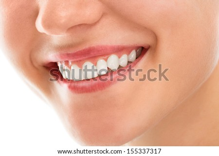 A woman is smiling while being at the dentist - stock photo