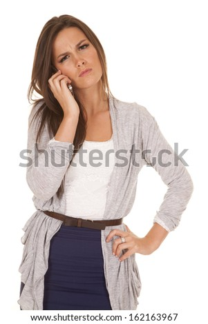 A woman is talking on the phone with a mad face expression. - stock photo
