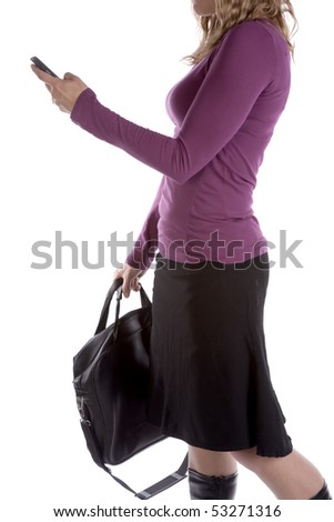 A woman is texting and holding a briefcase. - stock photo