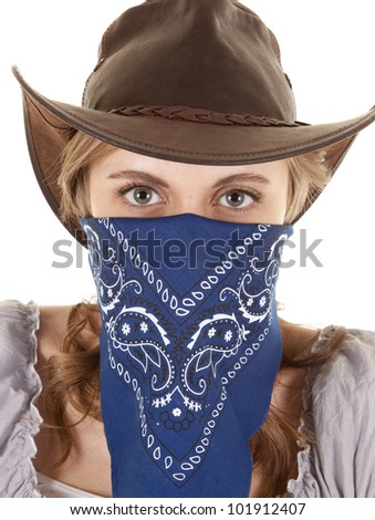 A woman is wearing a bandanna and looking straight forward. - stock photo