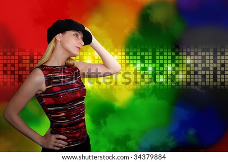 A woman is wearing a black hat and is dancing at an entertainment  nightclub. The background has glowing colored, rainbow squares. Add your text in this area or leave it blank. - stock photo