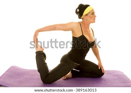 A woman kneeling and stretching out her legs looking - stock photo