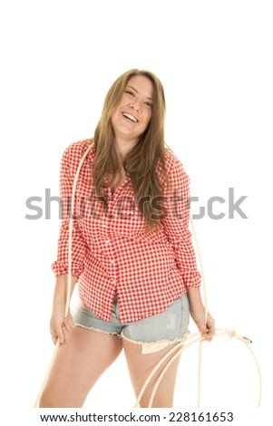 A woman laughing and smiling holding on to her rope. - stock photo
