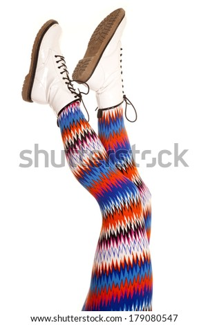 A woman legs with colorful pants up in the air. - stock photo