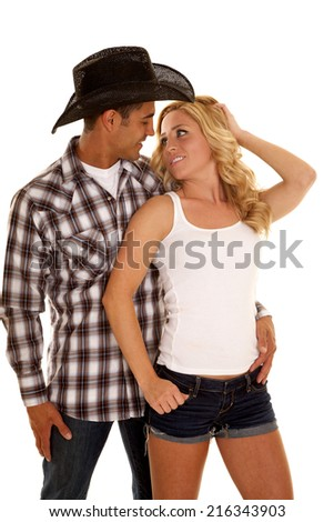 a woman looking into her cowboys eyes. - stock photo