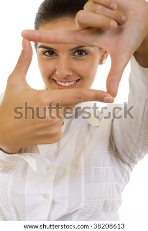 A woman looking threw her fingers finding the angle - stock photo