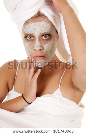 A woman looks unsure of herself at the spa. - stock photo