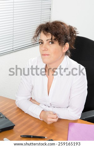 A  Woman manager working at the office - stock photo