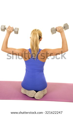 a woman on her knees working out with weights. - stock photo