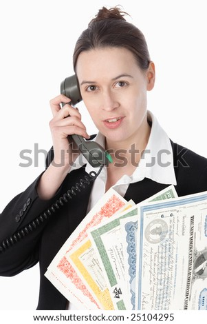 A woman on the line with a selection of bonds on a white background. - stock photo