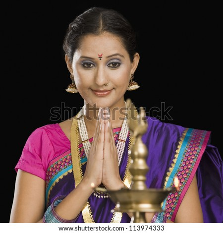 A woman praying - stock photo