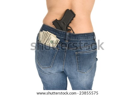 A woman prepares herself to protect her money. - stock photo