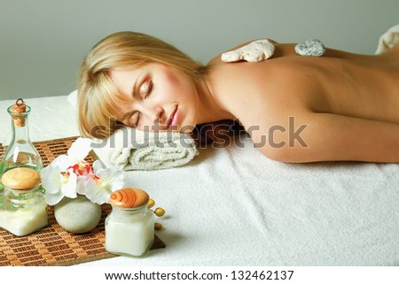 A woman relaxing during a spa stone therapy - stock photo