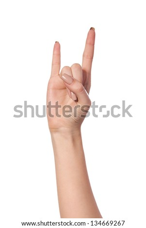 A woman's hand giving the Rock and Roll sign isolated on a white background - stock photo