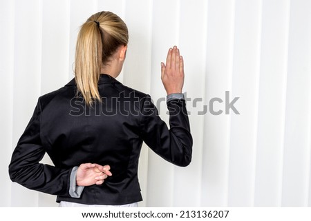a woman says as a witness in court in a lawsuit. symbol photo for false statement - stock photo