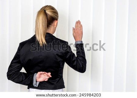 a woman says as a witness in court in a lawsuit. symbolic photo for false statement - stock photo