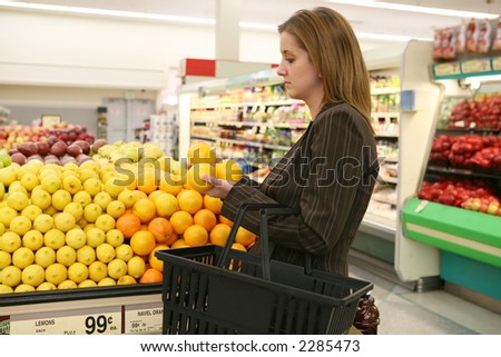 A woman shopping in the grocery store - stock photo
