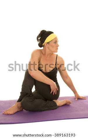 a woman sitting on her butt doing a stretch. - stock photo