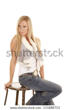 A woman sitting on her stool with a serious expression on her face. - stock photo