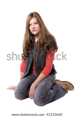 A woman sitting  with a sad and serious look on her face. - stock photo