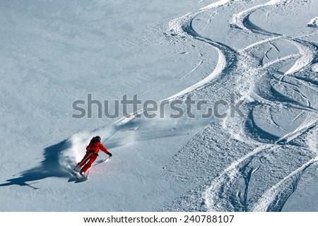A woman skiing in fresh powder snow, Utah, USA. - stock photo