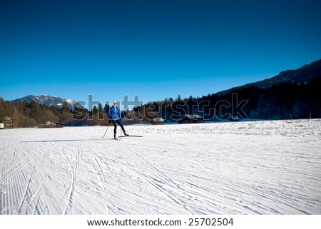 A woman skiing in the mountains. Nordic or skate style. - stock photo