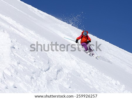 A woman skiing on a sunny winter day, Utah, USA. - stock photo