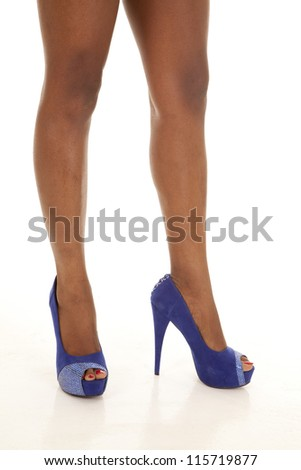 A woman standing in her dark blue heeled shoes. - stock photo