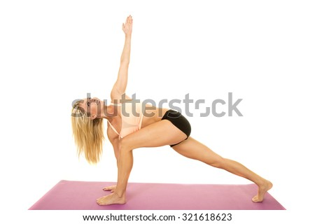 A woman stretching on her fitness mat showing off her flexibility. - stock photo