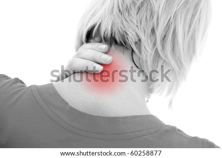 A woman suffering pain on her neck - stock photo