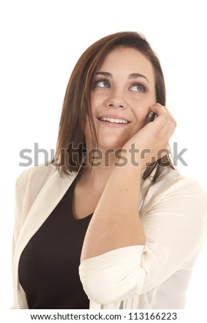 A woman talking on her phone with a smile on her face - stock photo