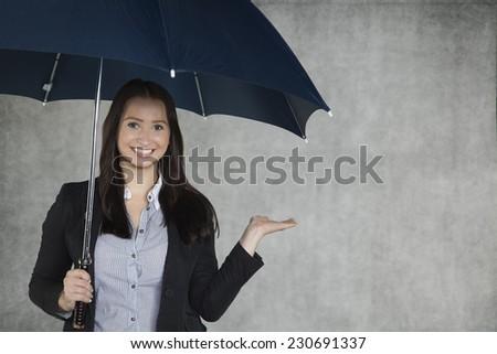 A woman under an umbrella - stock photo
