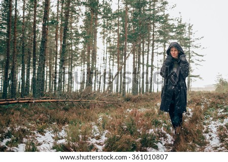 A woman walking through a forest - stock photo