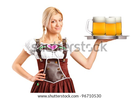 A woman wearing traditional costume and holding three beer glasses isolated on white background - stock photo