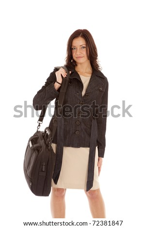 A woman with a black top is holding a bag. - stock photo
