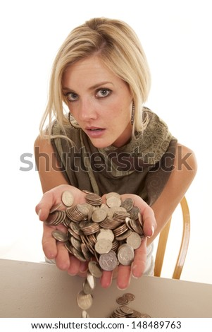 A woman with a handful of loose change. - stock photo
