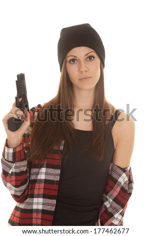 A woman with a serious expression on her face holding on to her pistol - stock photo