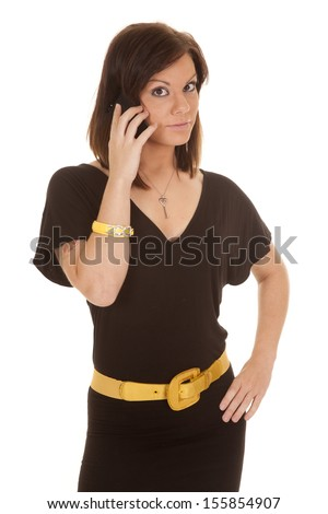 A woman with a serious expression on her face talking on her phone. - stock photo