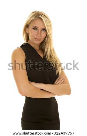 A woman with a serious face with her arms folded and a determined expression. - stock photo
