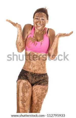 A woman with a smile on her face covered in mud. - stock photo
