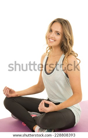 a woman with a smile on her face meditating with a smile - stock photo
