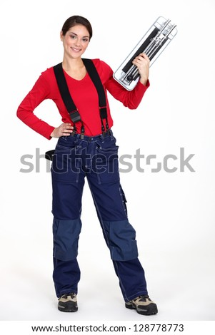 A woman with a tile cutter. - stock photo