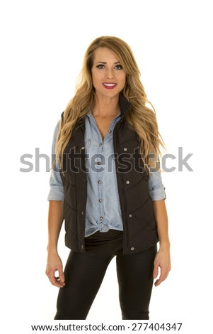 A woman with black vest stand look with smile - stock photo