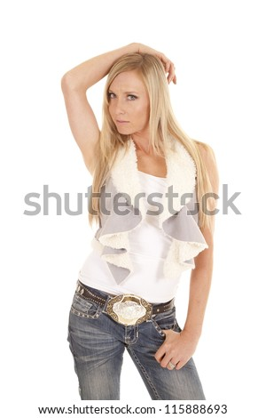 A woman with her arm on top of her head with a serious expression on her face. - stock photo