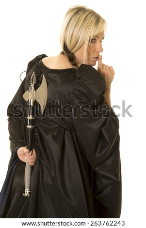 A woman with her finger up by her mouth, and a hatchet behind her back. - stock photo